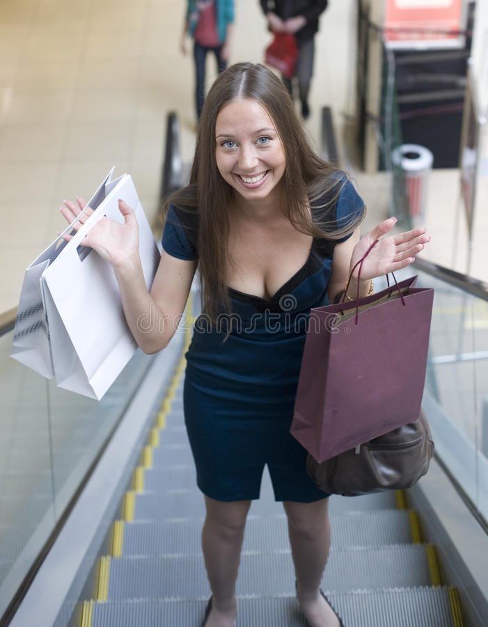Download Portrait Of Pretty Young Woman With Bags In The Shop Stock Photo - Image: 31986424