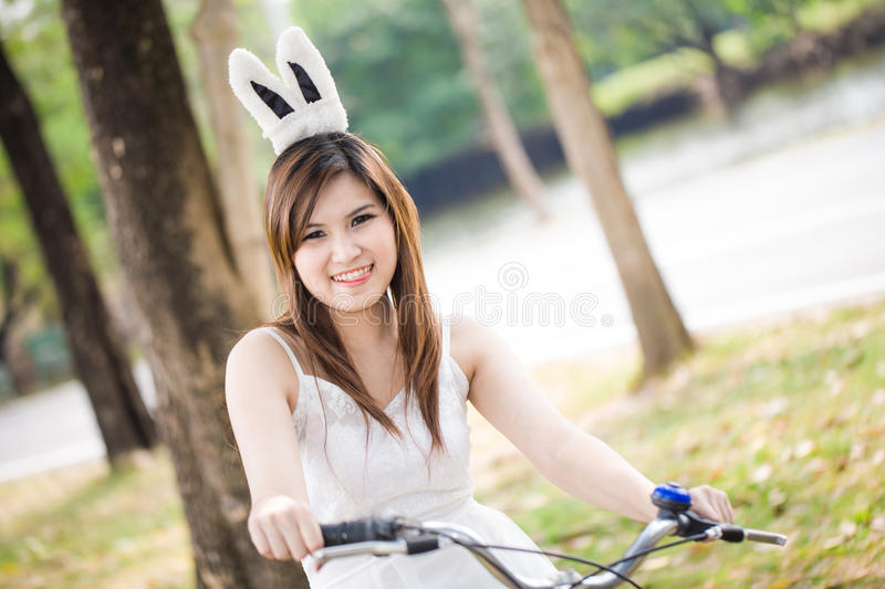 Download Portrait Of Pretty Young Woman With Bicycle In A Park Smiling Stock Image - Image of bicycle, leisure: 29030457