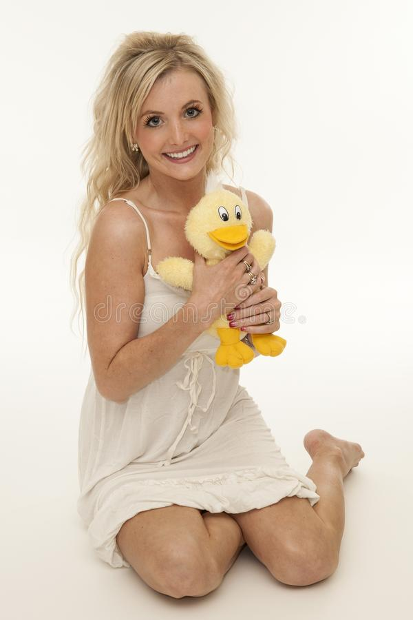 Young happy women with stuffed duck royalty free stock photo