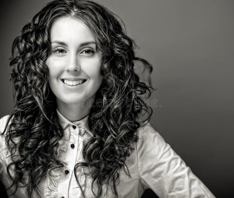 Download Portrait Of Pretty Young Woman With Curly Hair. Stock Photo - Image: 24746938