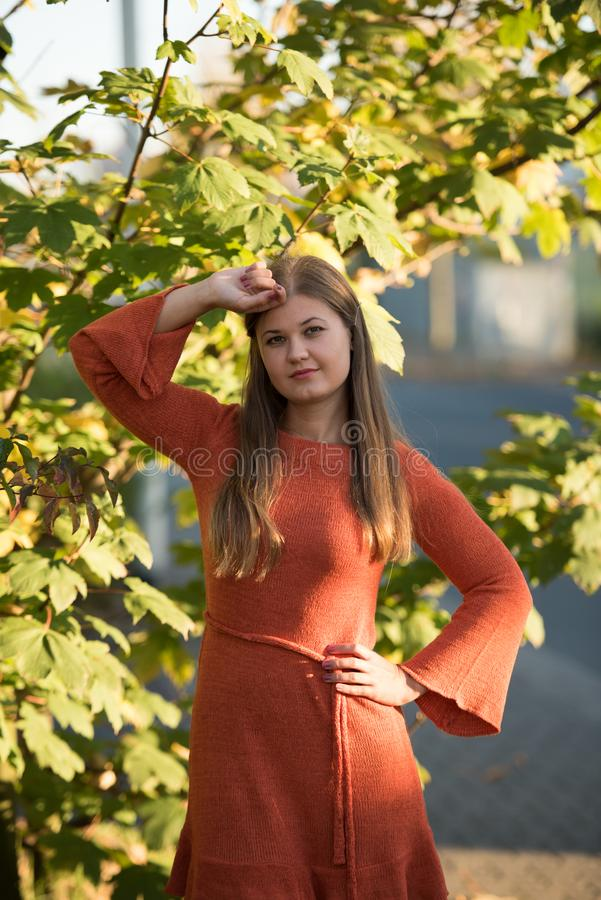 Portrait of young woman in park royalty free stock photos