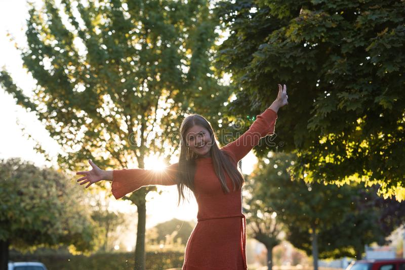Portrait of young woman in park stock photo