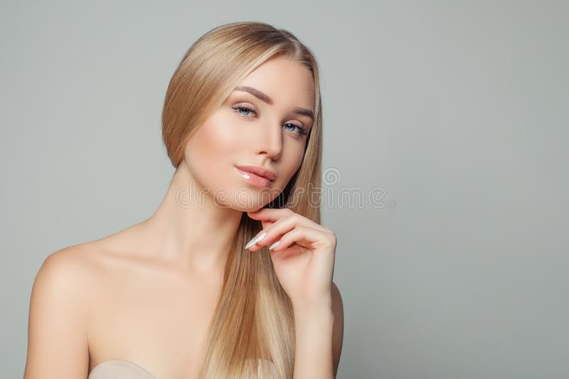 Portrait of pretty young woman with healthy blonde hairstyle and natural clear skin. Beauty girl. Hair and skin care concept stock photos