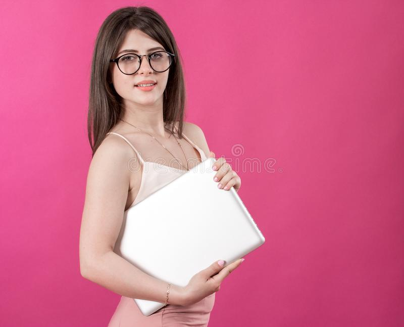 Portrait of pretty young woman with laptop royalty free stock photography