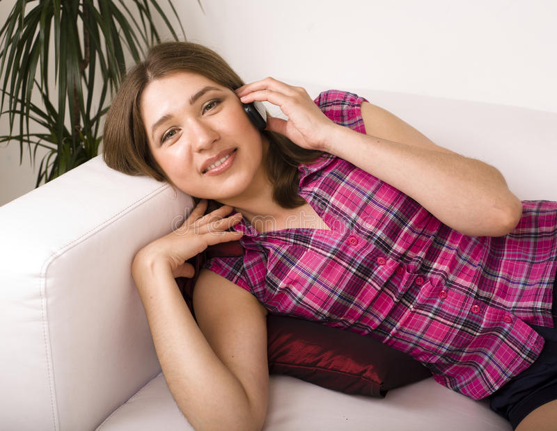 Download Portrait Of Pretty Young Woman Laying On Sofa Stock Photo - Image: 32869928