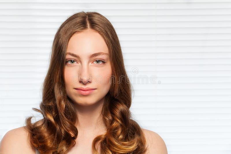 Pretty woman with wavy hair and clean face skin royalty free stock photo