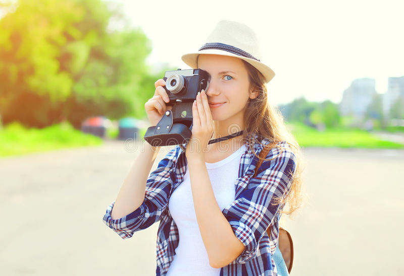 Portrait of pretty young woman with retro old vintage camera stock images