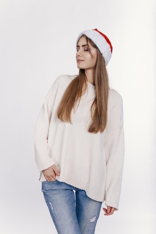 Portrait of pretty young woman in santa hatl stock photo