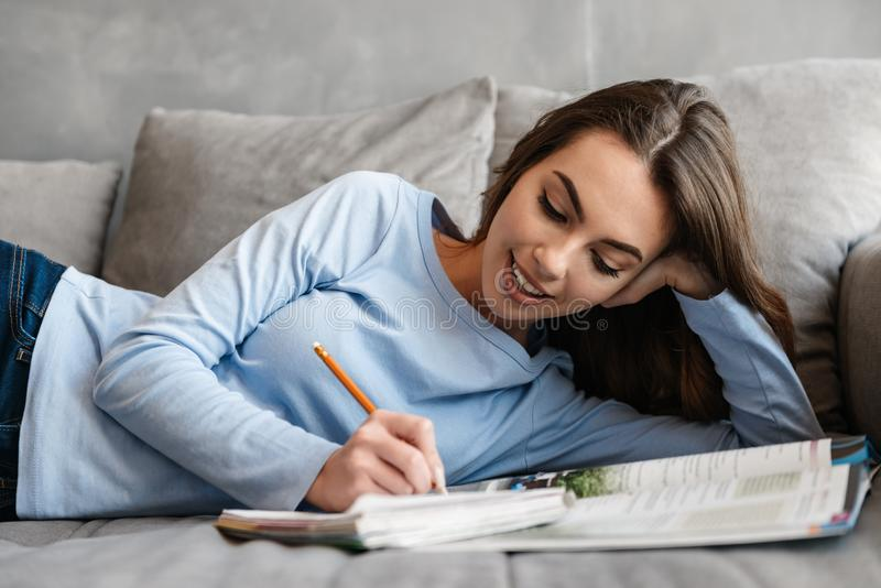 Portrait of a pretty young woman studying royalty free stock photography