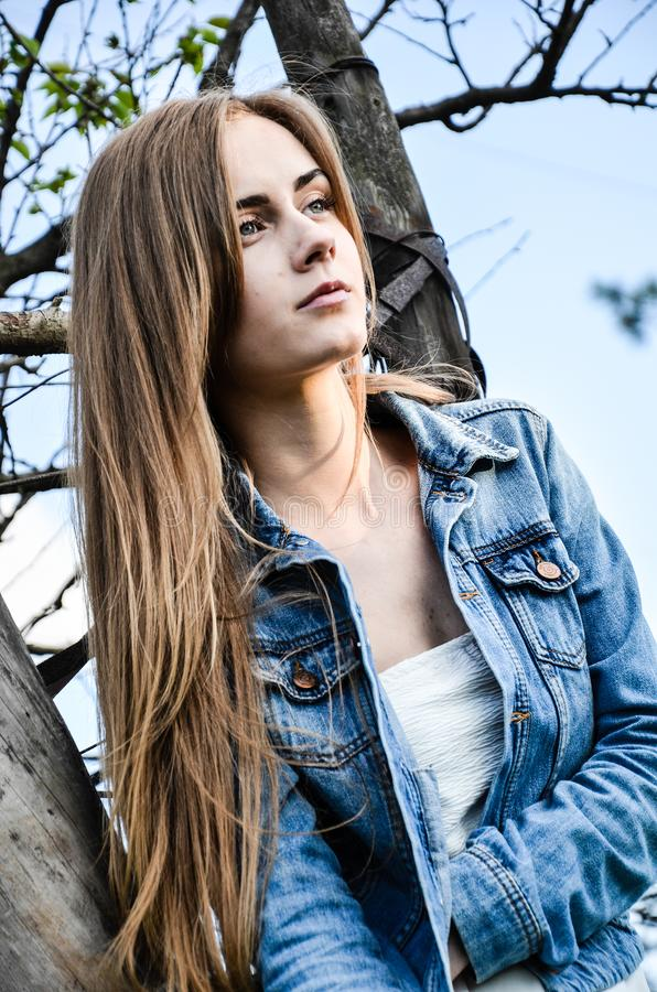 Portrait of the pretty young woman in stylish clothes stock photo