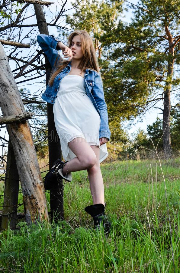 Portrait of the pretty young woman in stylish clothes royalty free stock image