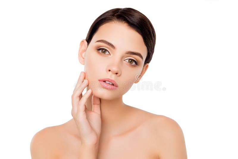 Portrait of pretty young woman touching her cheek, Isolated on white background. Touching pure ideal flawless skin. with hands. CL royalty free stock images