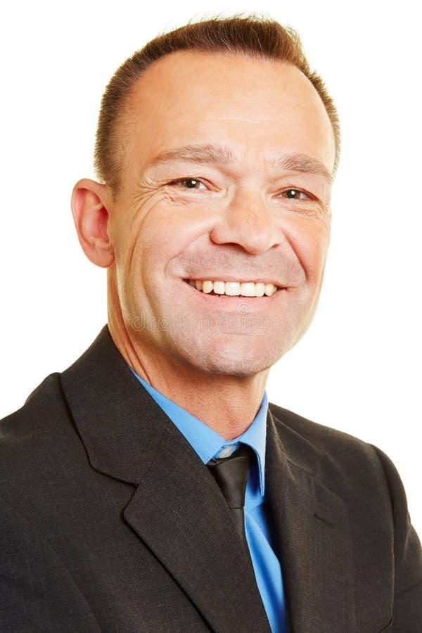 Portrait principal de tir de directeur de sourire image stock