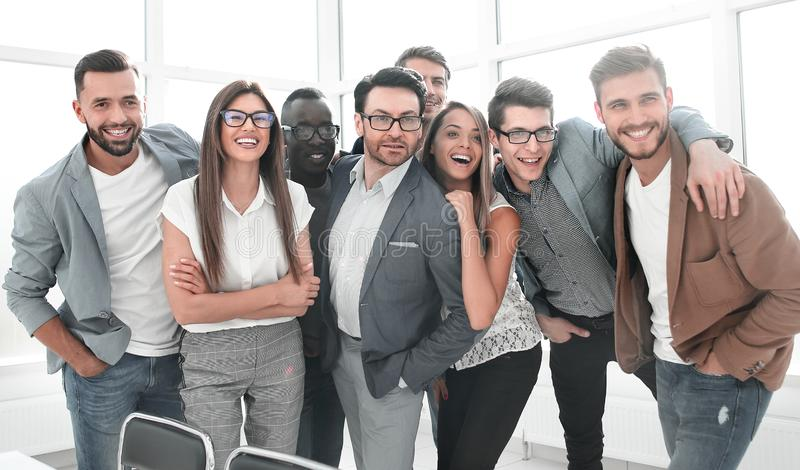 Portrait of a professional business team standing in a modern office royalty free stock image