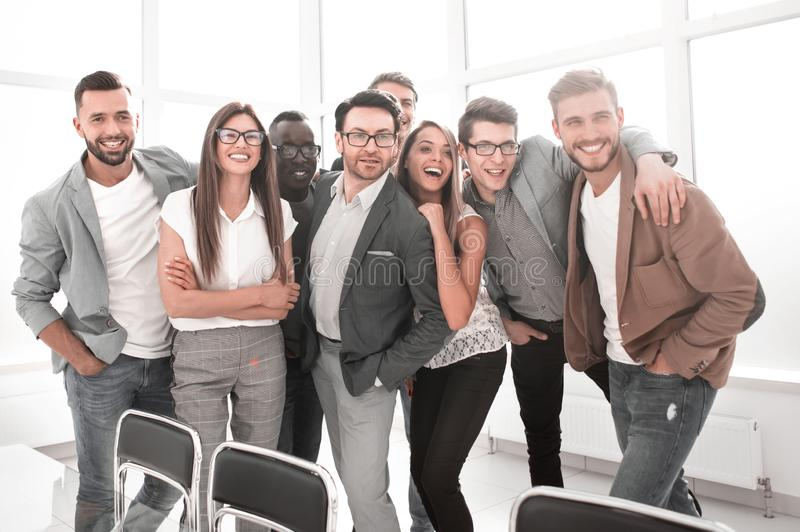 Portrait of a professional business team standing in a modern office stock images