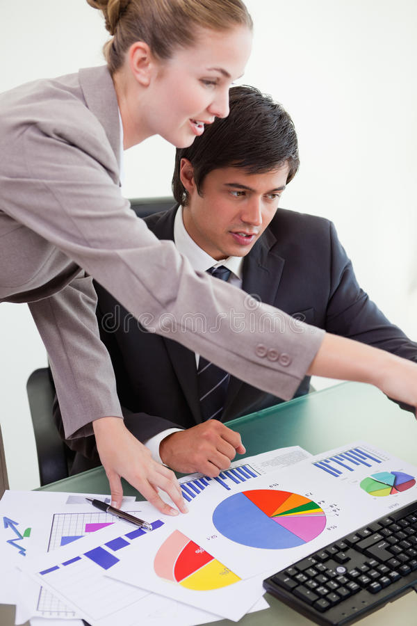 Download Portrait Of A Professional Business Team Studying Statistics Stock Images - Image: 22349254