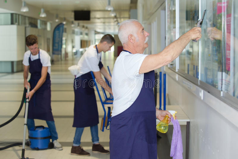 Portrait professional cleaners team at work stock photography