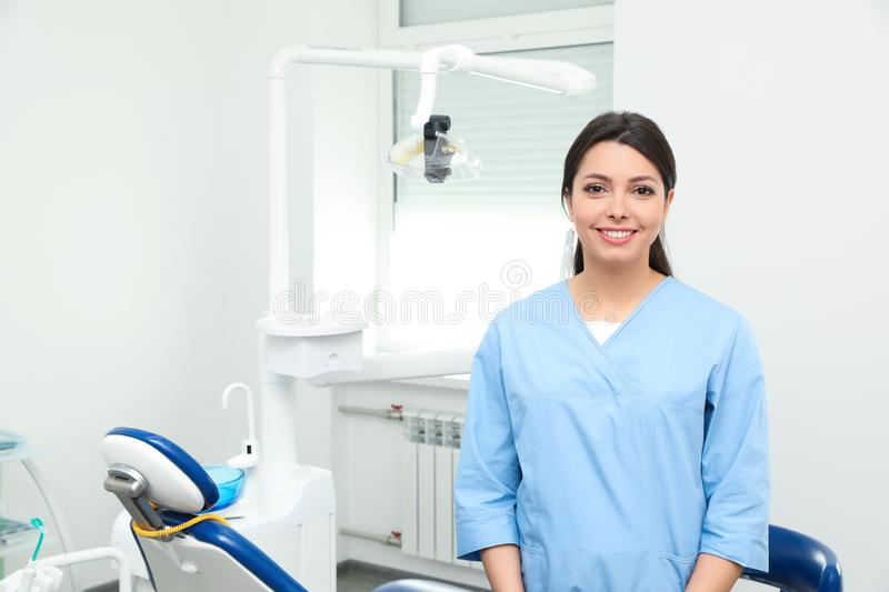 Portrait of professional female dentist in clinic royalty free stock photo