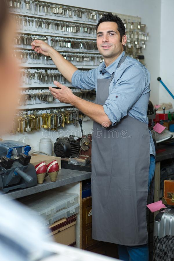 Portrait professional key cutter and cobbler stock photo