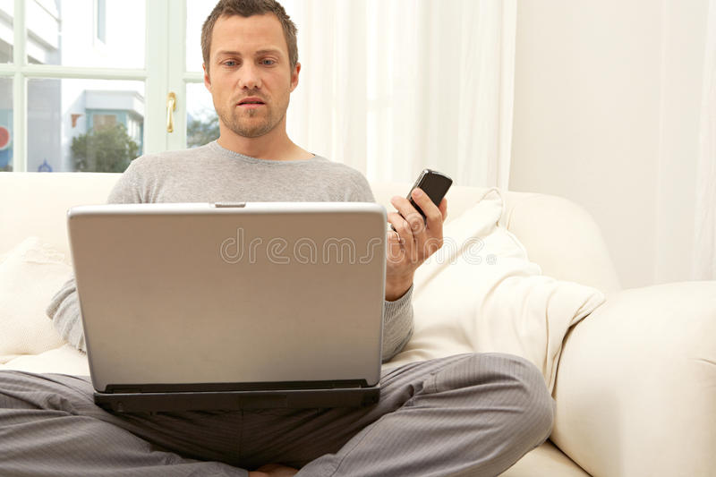 Download Portrait Of Professional Man With Laptop And Smart Phone At Home. Stock Image - Image: 29315011