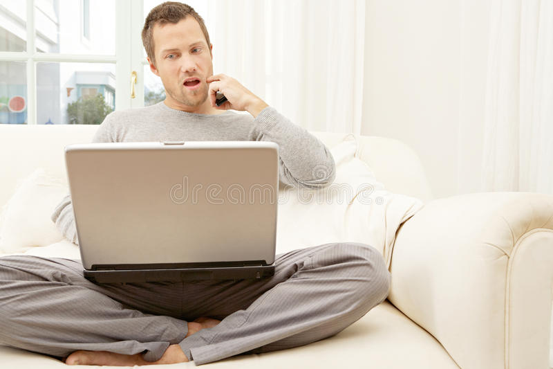 Download Portrait Of Professional Man With Laptop And Smart Phone At Home. Stock Photo - Image of happy, couch: 29315070
