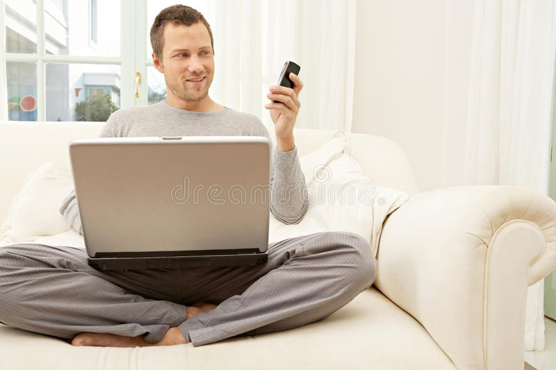 Download Portrait Of Professional Man With Laptop And Smart Phone At Home. Stock Image - Image: 29315089