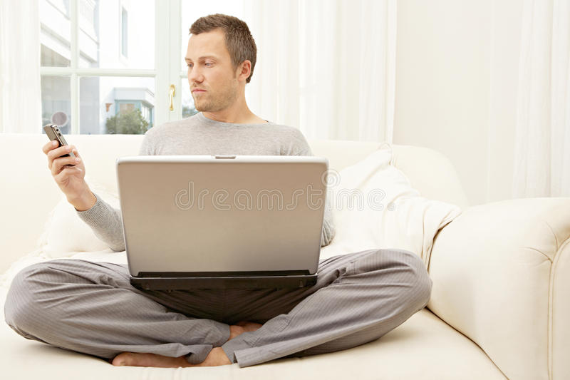 Download Portrait Of Professional Man With Laptop And Smart Phone At Home. Stock Photo - Image: 29315112