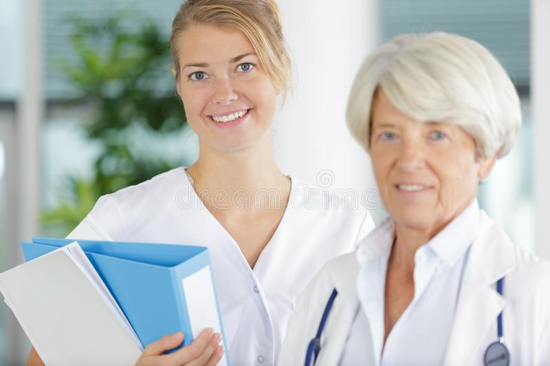 Portrait professional nurse and mature female doctor stock photography