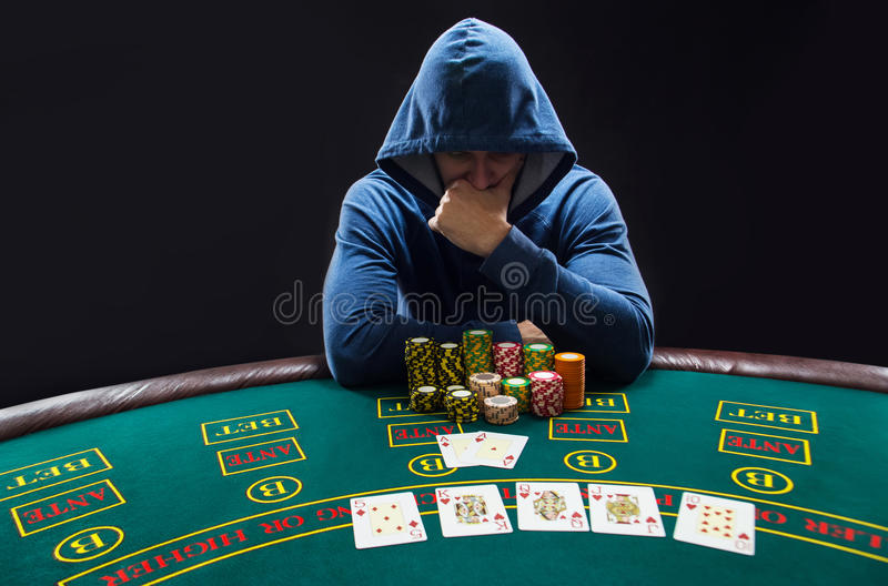 Portrait Of A Professional Poker Player Sitting At Pokers ...