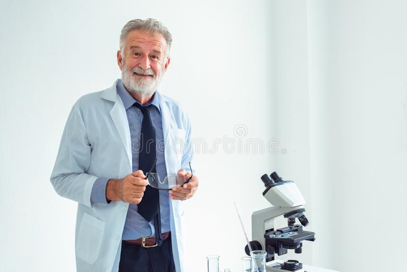 Portrait of professional researcher lab standing against white b royalty free stock photography