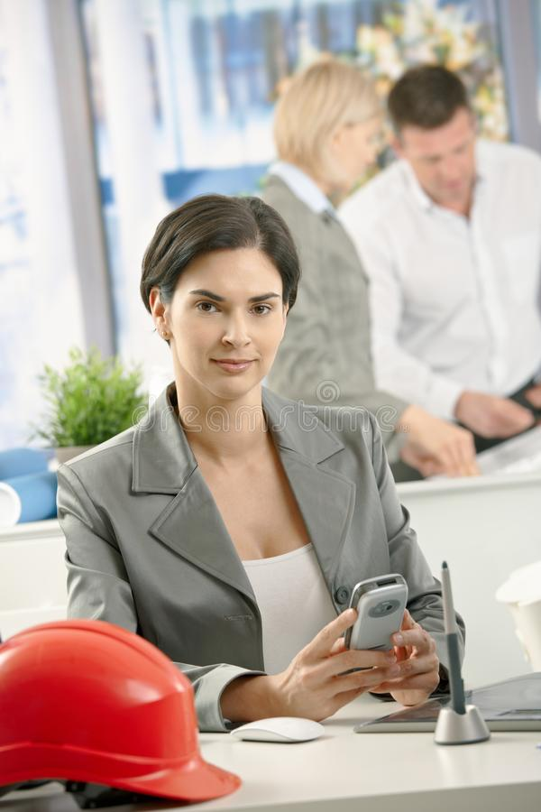 Portrait of professional with smartphone stock image
