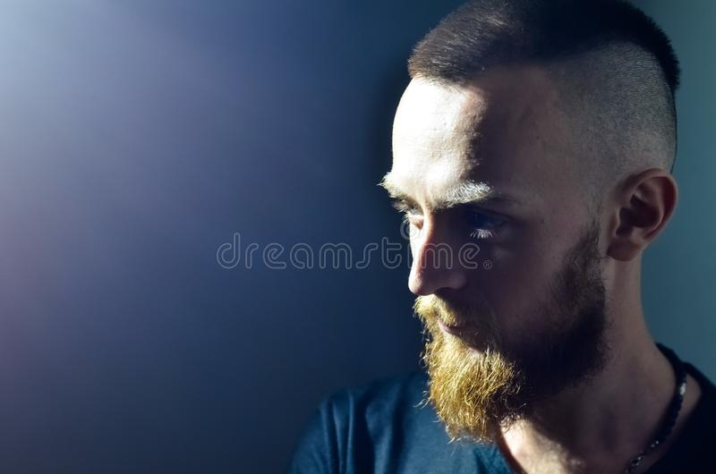 Close-up face profile portrait strong serious brutal bearded man royalty free stock photos
