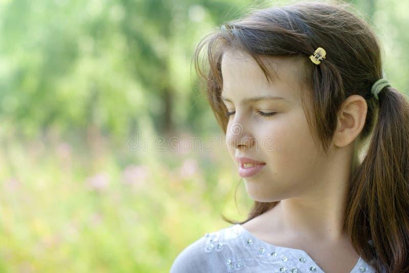 Portrait in profile of cute brunette girl stock photo