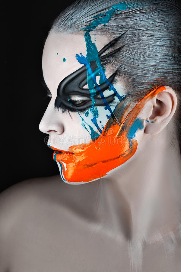 Portrait in profile with streaks of paint. stock image