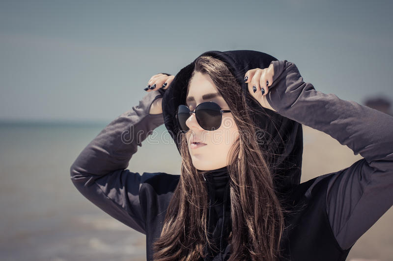 Portrait in profile of a teenage girl in sunglasses stock image