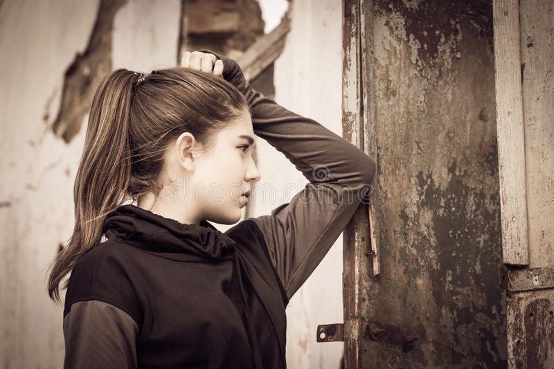 Portrait in profile of a thoughtful teenage girl stock images