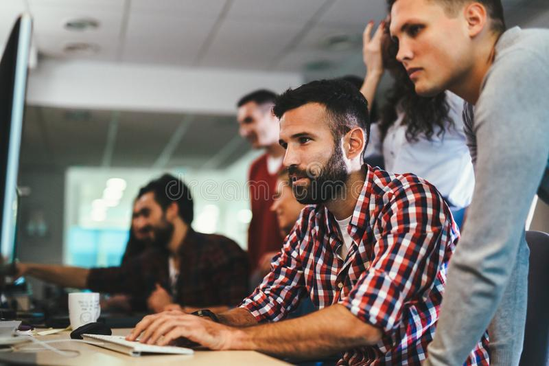 Portrait of programmers working in development software company royalty free stock photo