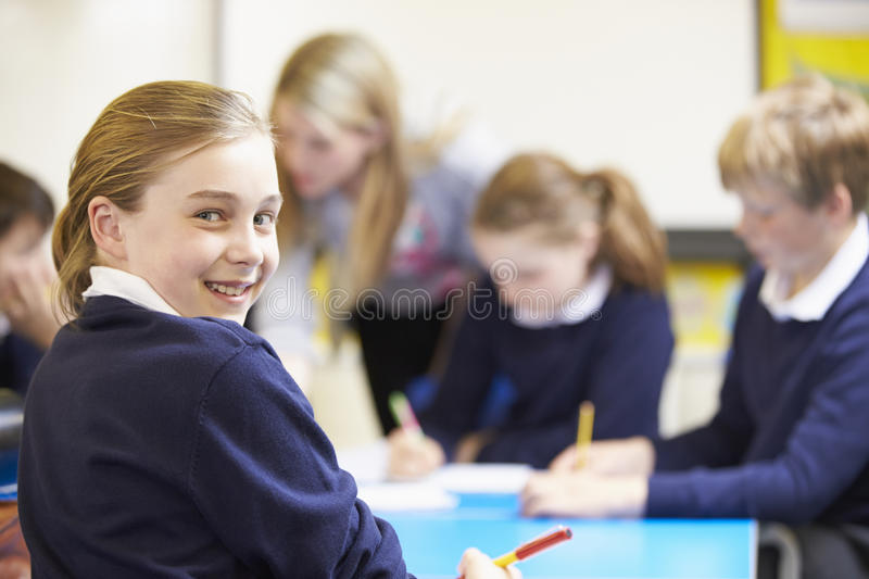 Portrait Of Pupil In Classroom With Teacher stock photos
