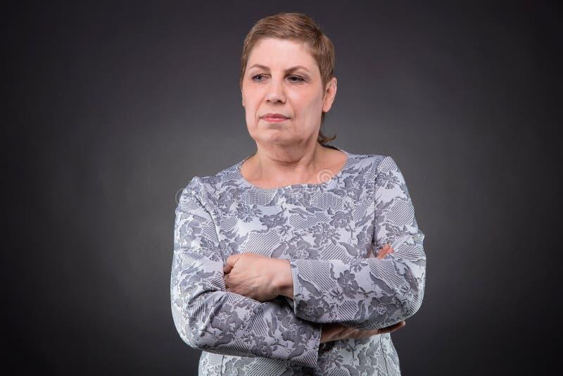 Portrait of puzzled senior woman stock images