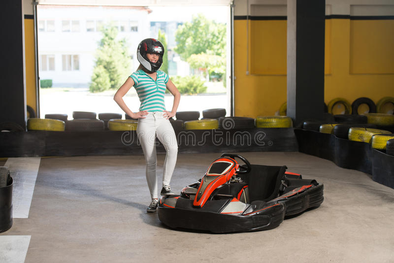 Portrait Of A Race Karting Man. Young Woman Is Driving Go-Kart Car With Speed In A Playground Racing Track - Go Kart Is A Popular Leisure Motor Sports stock photo