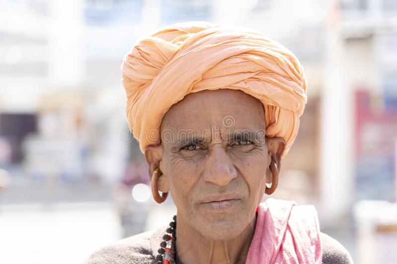 Portrait of Rajasthani man wearing traditional dress and turban visit to holy city Pushkar, Rajasthan, India, close up royalty free stock photography