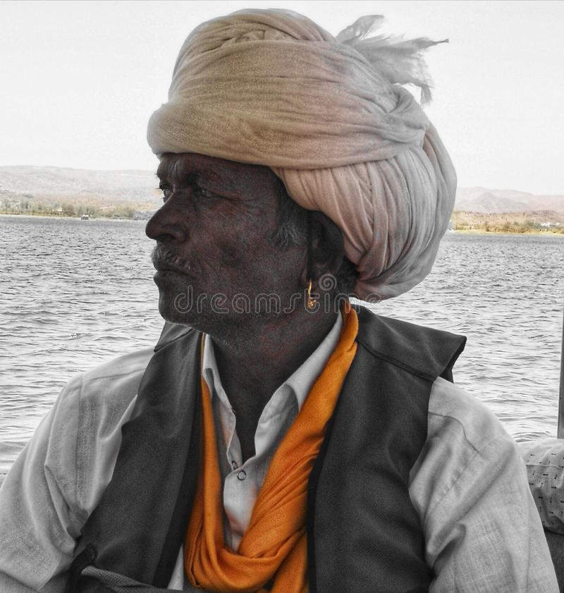 Portrait of a Rajput man on a boat in Udaipur India royalty free stock image