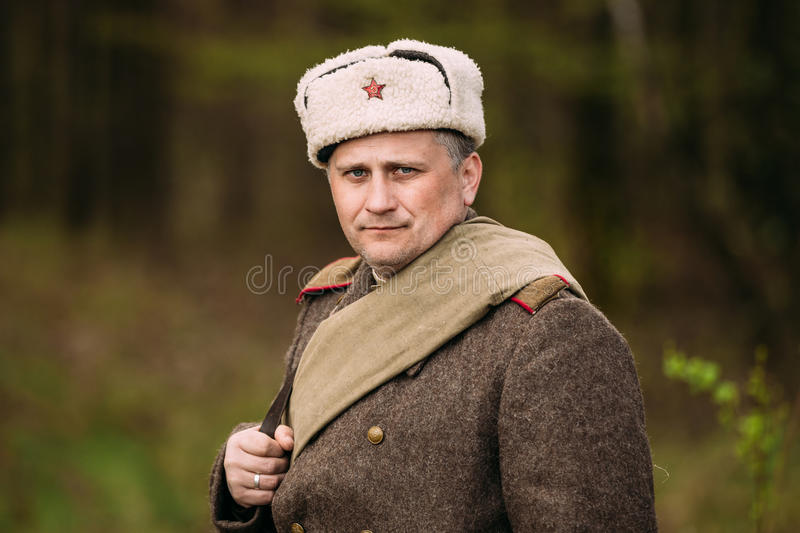 Portrait Re-enactor Dressed As Russian Soviet Red Army Infantry. Pribor, Belarus - April 23, 2016: Close up portrait of Re-enactor Dressed As Russian Soviet Red royalty free stock photo