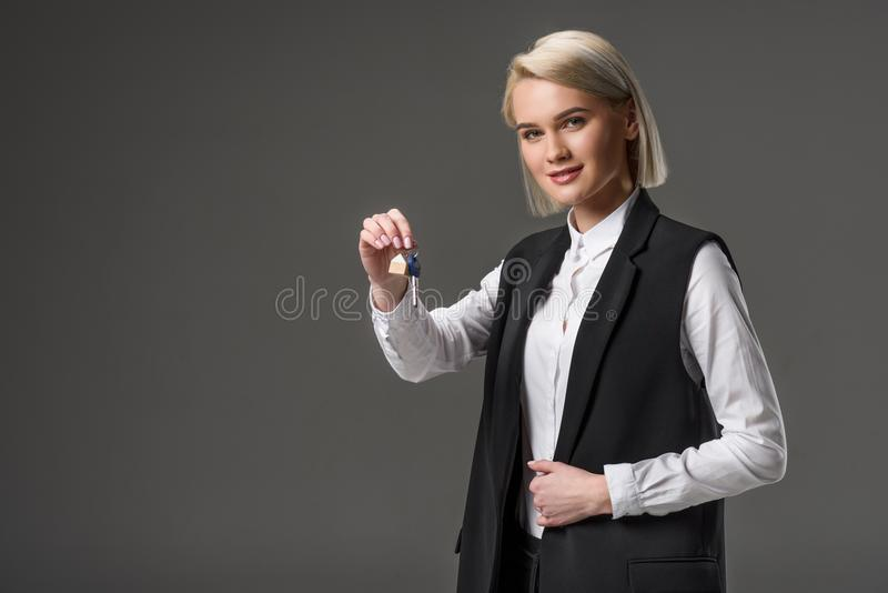 portrait of real estate agent with keys in hand stock photo