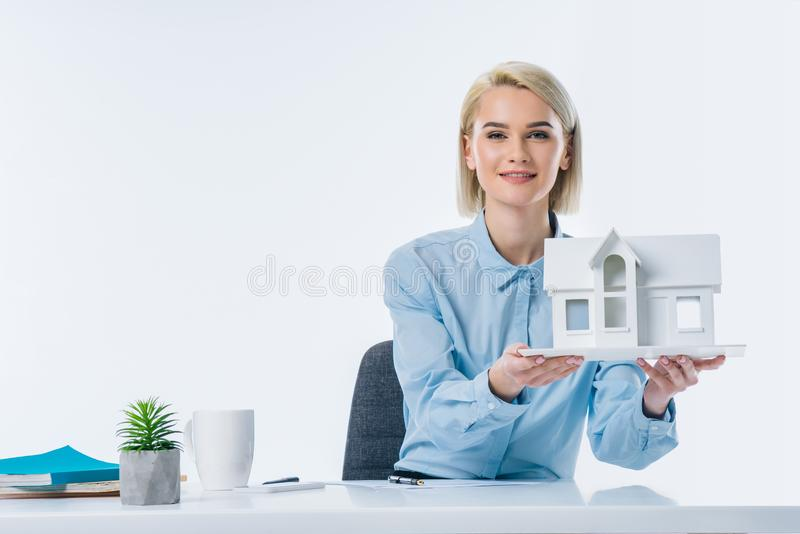 portrait of real estate agent showing house model royalty free stock image