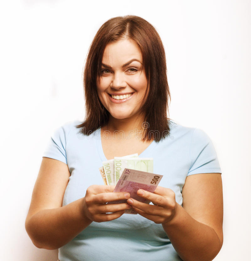 Portrait of real fat young woman with money stock photography