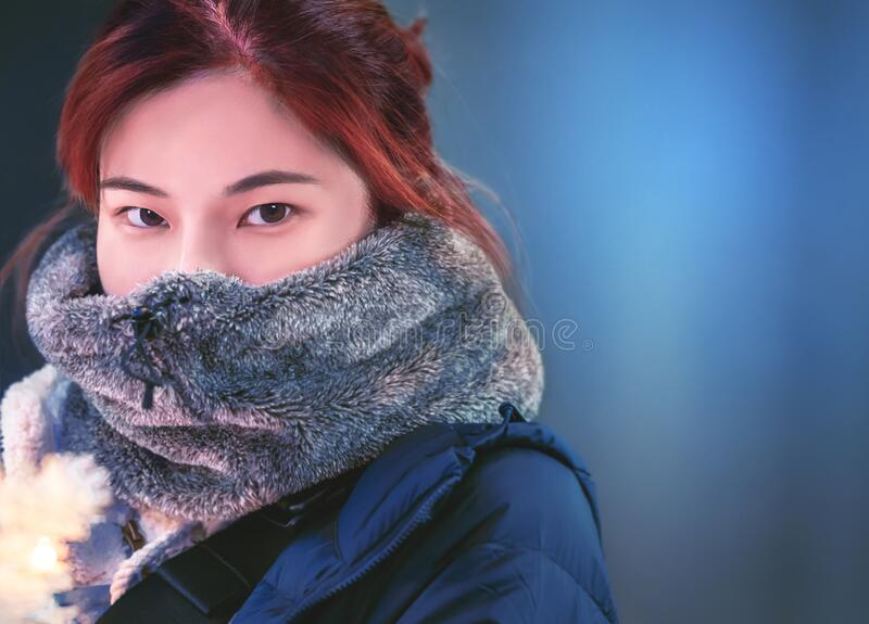 Portrait of Red hair woman in winter clothing for beauty skin and fashion concept. Portrait of Red hair Asian woman in winter clothing for beauty skin and stock photography