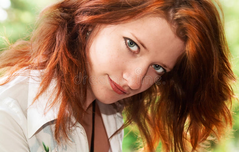 Portrait of the red-haired girl stock photos