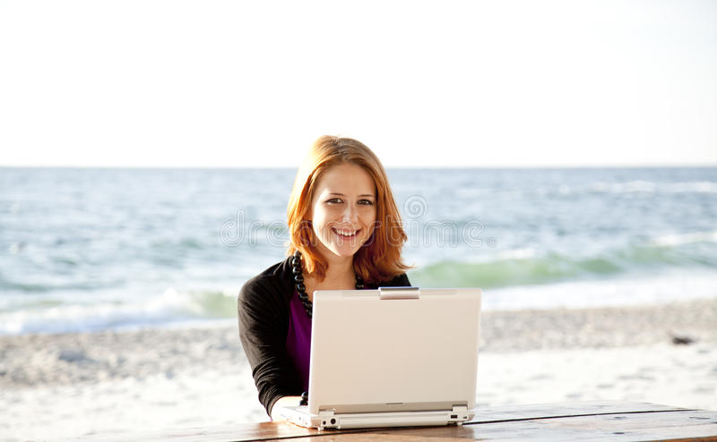 Portrait Of Red-haired Girl With Laptop At Beach. Stock Photos