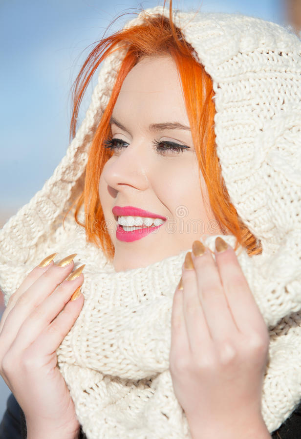 Portrait red haired happy girl in warm white scarf outdoor stock photography